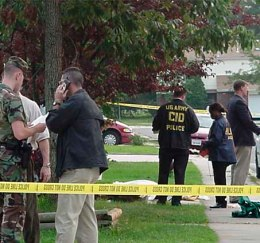 US Army CID agents at crime scene (image is in public domain)