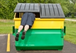 trash hit man in dumpster
