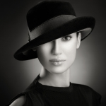 fedora on woman black and white