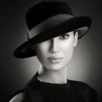 fedora on woman black and white