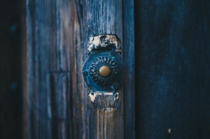 old doorbell blue door