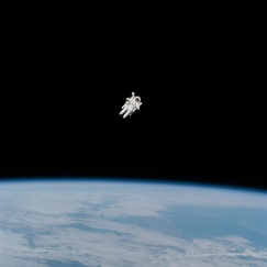 Astronaut in space over Earth