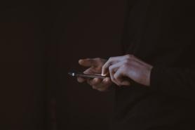 Checking smartphone screen in the dark