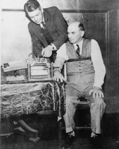 American inventor Leonarde Keeler (1903-1949) testing his lie-detector on Dr. Kohler, a former witness for the prosecution at the trial of Bruno Hauptmann, 1937 (image is in the public domain)