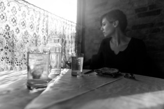 black-white-woman-along-at-table-drinking-gratisograph-ryan-mcguire